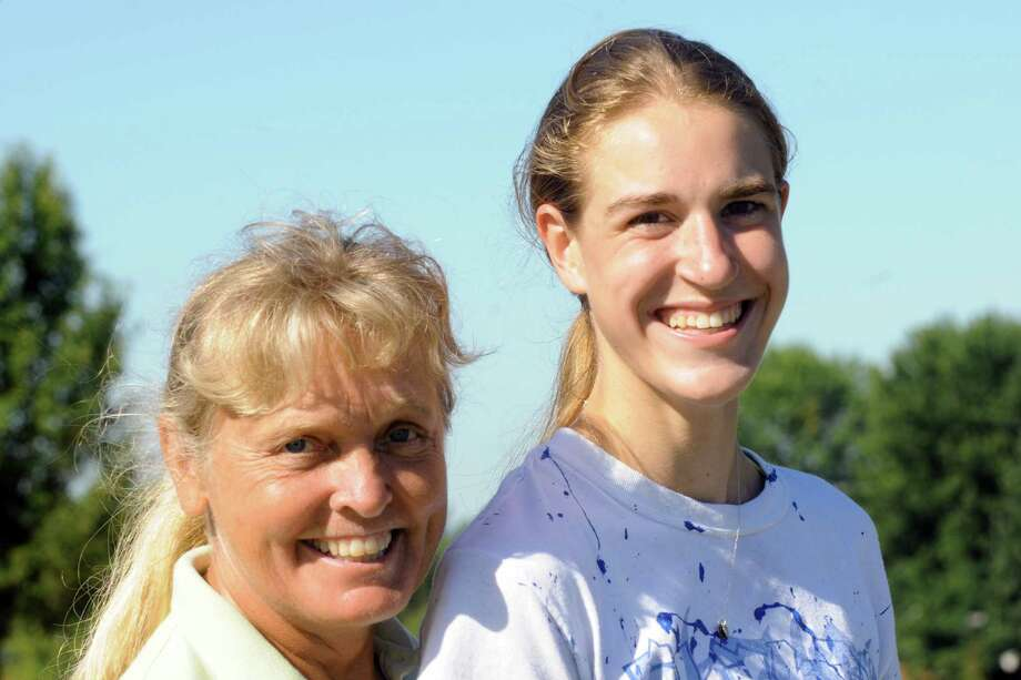 Shaker High School cross country runner Maryanna Lansingon with head coach Marbry Gansle on Saturday Aug. 24, 2013 in Colonie, N.Y. (Michael P. Farrell/Times Union) Photo: Michael P. Farrell / 00023620A
