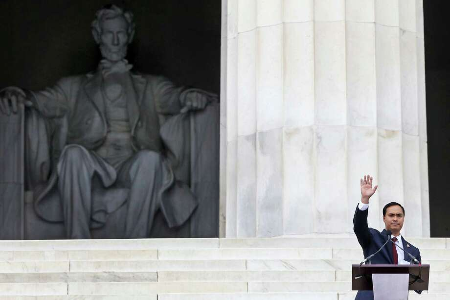 Rep. Joaquin Castro waves as he speaks at the 50th Anniversary of the March on Washington.   Photo: Charles Dharapak, Associated Press