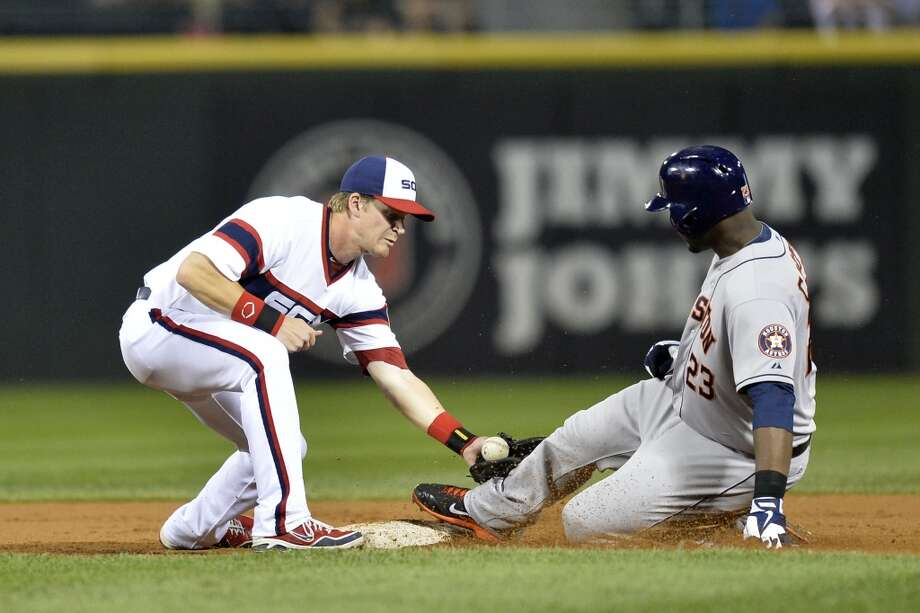 Aug. 28: White Sox 6, Astros 1  Chris Carter slides safely into second base with a double. Photo: Brian Kersey, Getty Images