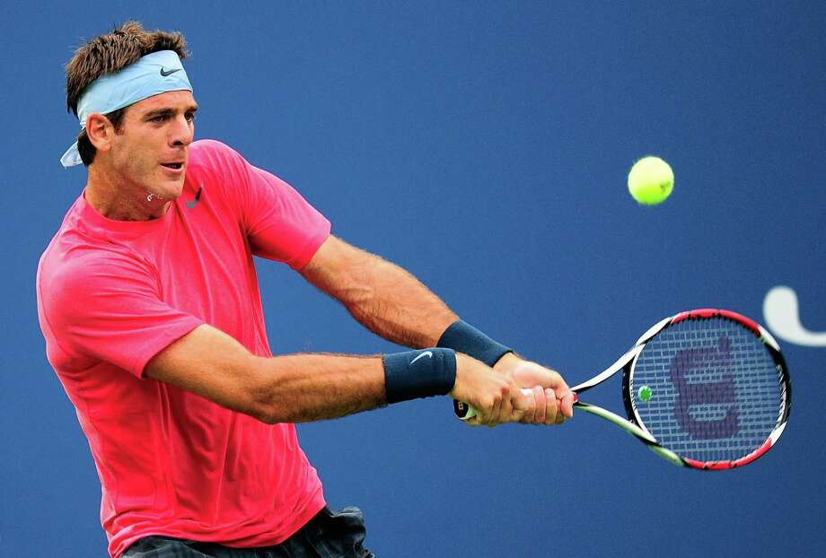NEW YORK, NY - AUGUST 28:  Juan Martin Del Potro of Argentina returns a shot to Guillermo Garcia-Lopez of Spain during their men's singles first round match on Day Three of the 2013 US Open at USTA Billie Jean King National Tennis Center on August 28, 2013 in the Flushing neighborhood of the Queens borough of New York City.  (Photo by Maddie Meyer/Getty Images) ORG XMIT: 177641527 Photo: Maddie Meyer / 2013 Getty Images
