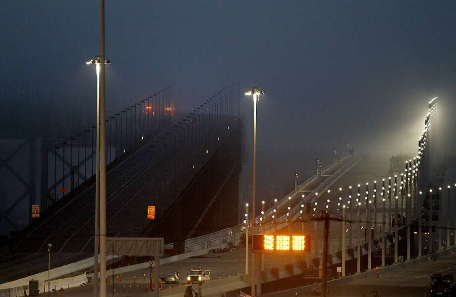 The old Bay Bridge (left) was closed down at 8 pm as work began on the new span (right). The Bay Bridge was closed Wednesday August 28, 2013 to finish the building of the new billion dollar eastern span. Photo: Brant Ward, The Chronicle