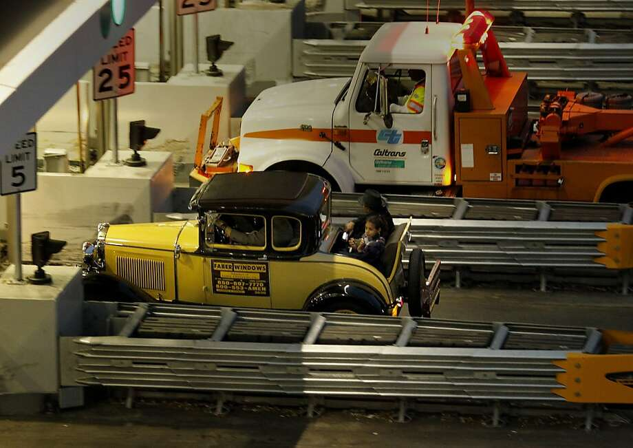 A 1930 Model A was the last car allowed to cross the eastern span and was escorted by two tow trucks. The Bay Bridge was closed Wednesday August 28, 2013 to finish the building of the new billion dollar eastern span. Photo: Brant Ward, The Chronicle