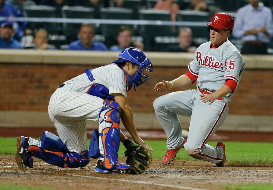 NEW YORK, NY - AUGUST 28:  Cody Asche #25 of the Philadelphia Phillies slides in ahead of the tag of Travis d'Arnaud #15 of the New York Mets and scores on Cole Hamel's two run single in the fifth inning at Citi Field on August 28, 2013 in the Flushing neighborhood of the Queens borough of New York City.  (Photo by Mike Stobe/Getty Images) ORG XMIT: 163495249 Photo: Mike Stobe / 2013 Getty Images