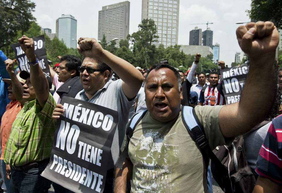 Teachers in Mexico City block a highway to protest reforms that would end unions' power over hiring and subject teachers to periodic evaluations in the form of standardized tests. Photo: Ronaldo Schemidt / AFP / Getty Images