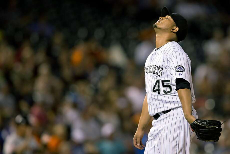Colorado's Jhoulys Chacin shows his disappointment after Brandon Crawford's hit. Photo: Justin Edmonds, Getty Images