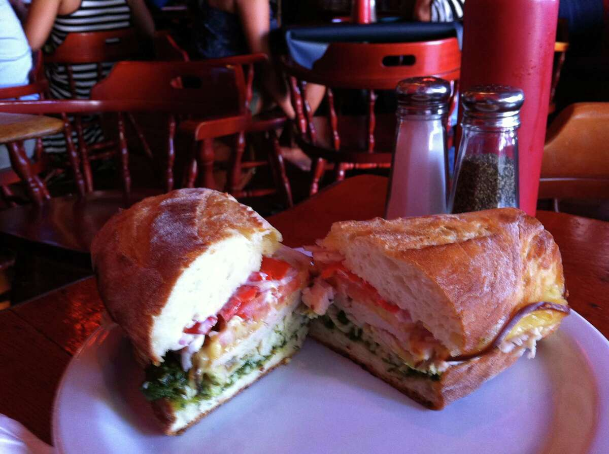 The Honey Hole: This casual space has good beer, many hipsters and tasty sandwiches, made with quality meat, veggies, fixins and bread. Pictured is the Waverider, a beast of a sandwich with house-roasted turkey, pesto, aioli, smoked gouda, onions and Mama Lil's sweet hot peppers. 703 E. Pike St., Capitol Hill. (Photo: Vanessa Ho/seattlepi.com).