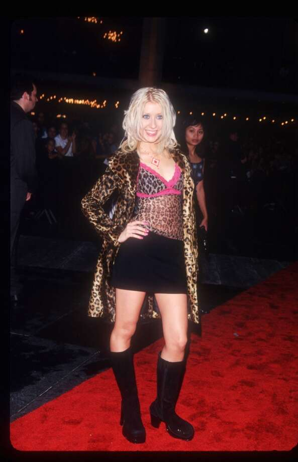 Christina Aguilera should have used her coat to cover her top. Photo: Evan Agostini, Getty Images