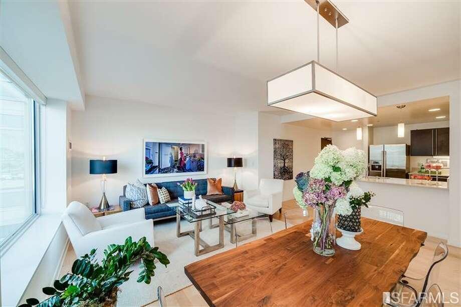Living plus dining. Photos via James Haywood, Paragon Real Estate Group/Redfin