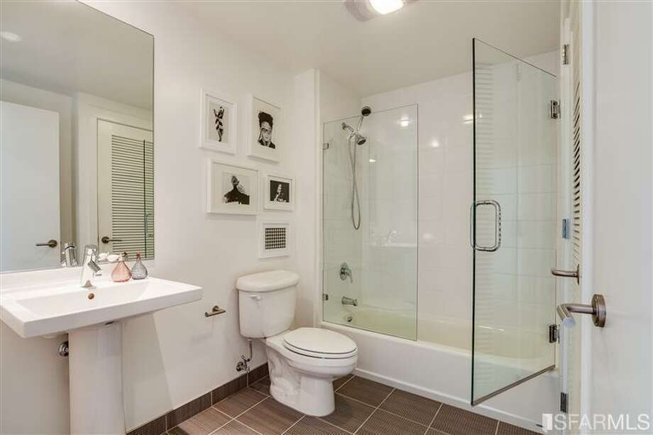Other bath. Photos via James Haywood, Paragon Real Estate Group/Redfin