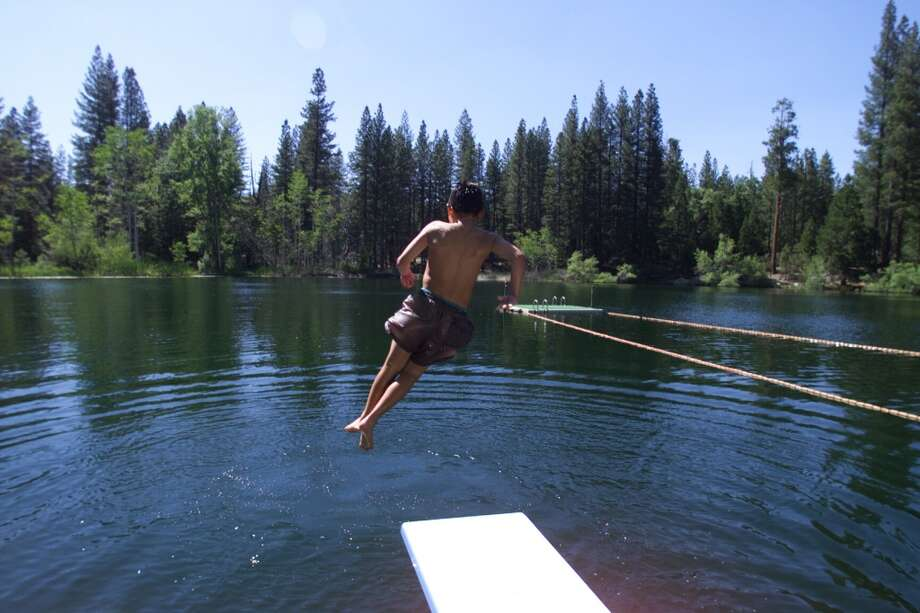 Camp Mather now. This boy takes a less daring approach than the diver in the 1940s photo. (I'm guessing it was the Johnny Weissmuller influence.) The lake looks exactly the same. Photo: Chris Stewart, The Chronicle