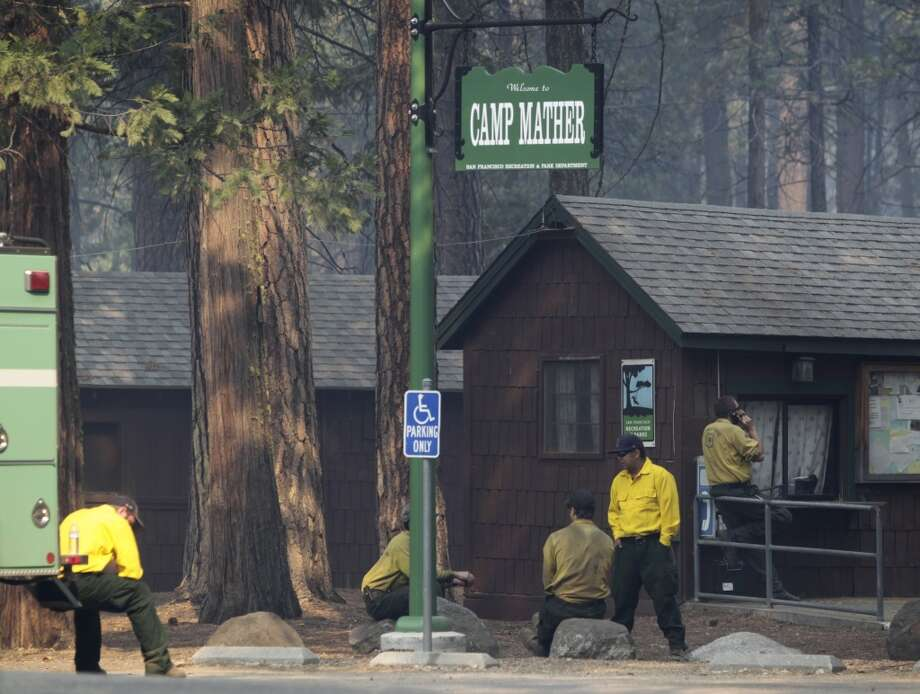 ... Clearly nothing changes at this place. The cabins look the same in this photo taken last week. Firefighters rest after battling the Rim Fire near Camp Mather. More on their efforts later. Photo: Paul Chinn, The Chronicle