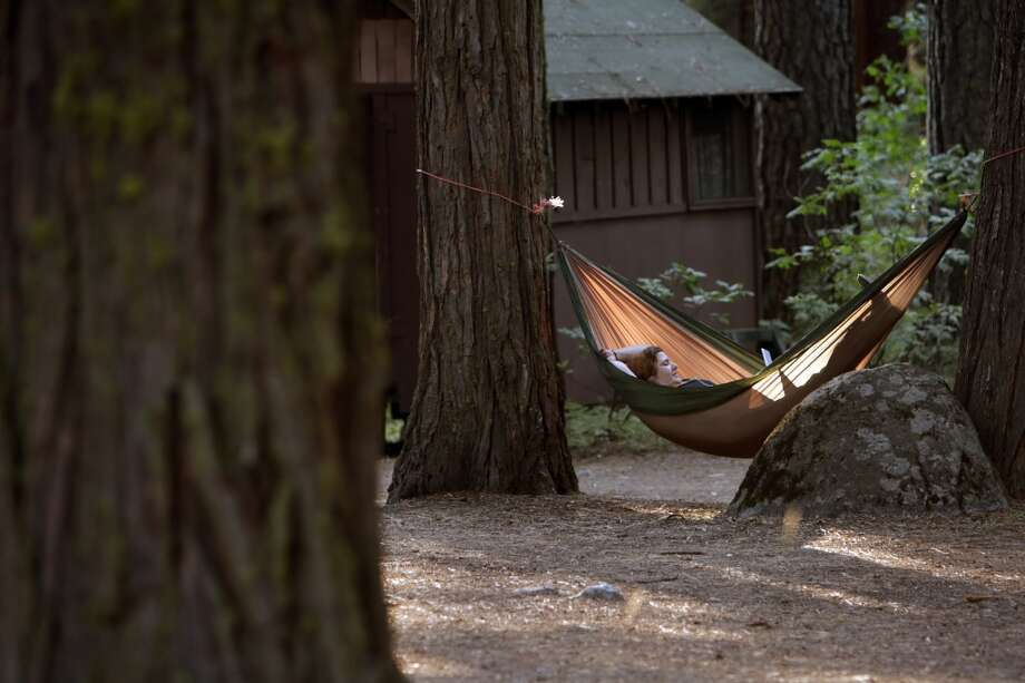 This photo was taken in 2009, one of several hammock photos in the modern Chronicle archive. Two things you don't want to forget at Camp Mather: A hammock and a lot of coins for the pay phone. Photo: Carlos Avila Gonzalez, The Chronicle