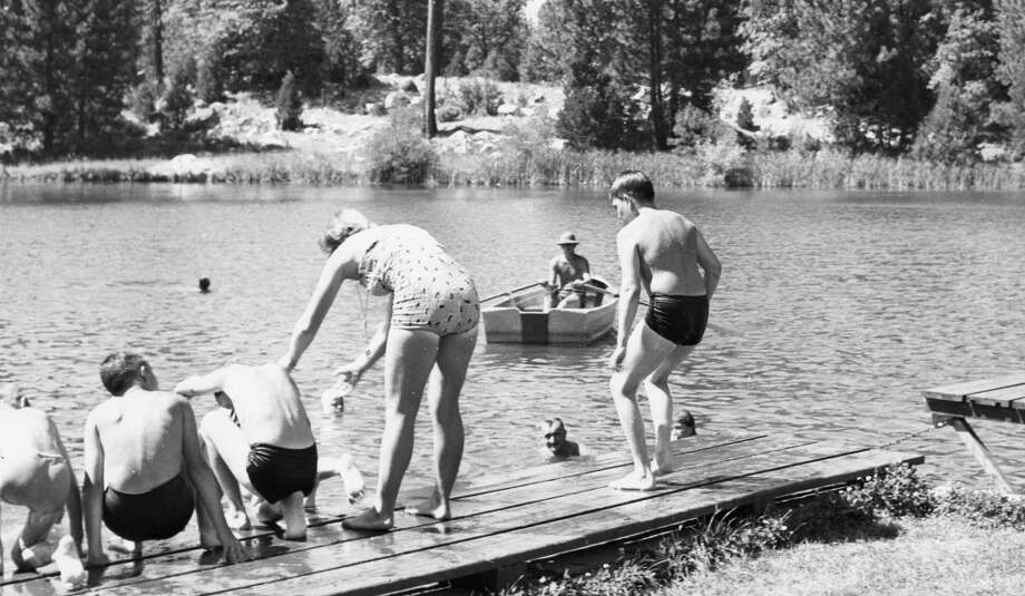April 28, 1964: Another photo of Birch Lake, and more proof of my swimsuit theory. Someone please confirm that 50 years later the Camp Mather rowboat pictured here is still in working condition. Photo: San Francisco Recreation Department