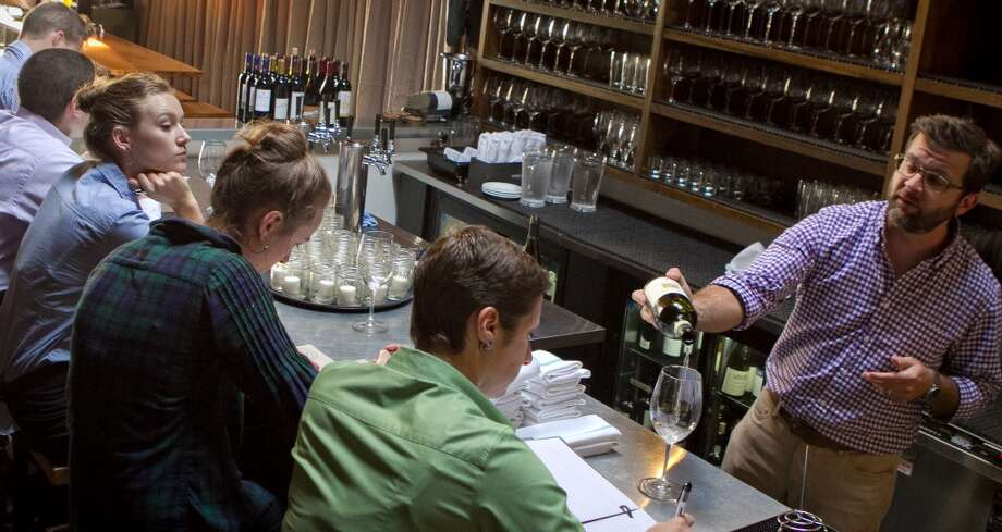 Sommelier/owner David Lynch pours wine at St. Vincent Photo: John Storey, Special To The Chronicle