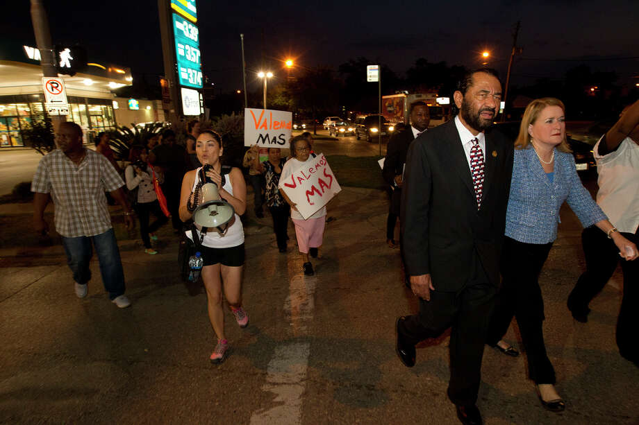 Protestors along with Congressman Al Green and State Senator Sylvia Garcia, right, walk in protest of wages paid to fast food employees, Thursday, Aug. 29, 2013, in Houston. Protestors joined the national movement to try and increase wages to $15 per hour for minimum wage. Photo: Cody Duty, Houston Chronicle / © 2013 Houston Chronicle