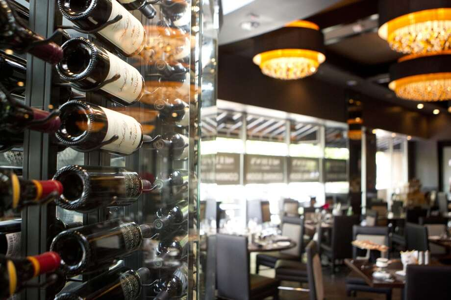 Wine wall inside Morton's Grille in the Woodlands. Photo: Johnny Hanson, Houston Chronicle
