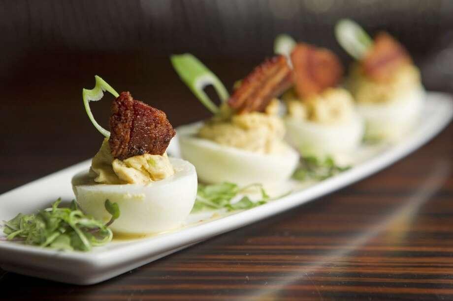 Bacon and eggs: deviled eggs, bacon, scallion and dijon vinaigrette at Morton's Grille. Photo: Johnny Hanson, Houston Chronicle