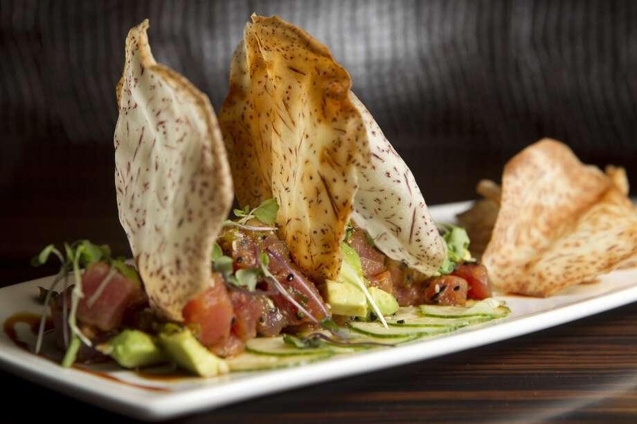 "Tuna Poke: Spicy ""Ahi"" tuna, avacado, sesame, soy caramel at Morton's Grille. Photo: Johnny Hanson, Houston Chronicle"