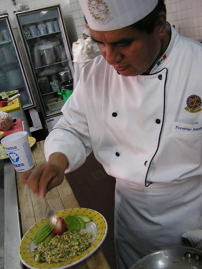 Chef Florentino Azpeitia prepares Escamoles at Los Girasoles restaurant in Mexico City. Escamoles is an Aztec dish of ant larvae that is increasingly popular.    Rolando Briseño served up his book touting food of Mexico back in 2010. Photo: DANE SCHILLER, SAN ANTONIO EXPRESS-NEWS / SAN ANTONIO EXPRESS-NEWS