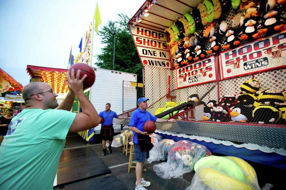 Brian LaMonica tries Hoop Shots at the St. Leo summer fair on Wednesday, Aug. 28, 2013. The fair runs through Saturday, August 31, 2013 at the Stamford, Conn., church grounds, 24 Roxbury Road. Photo: Lindsay Perry / Stamford Advocate