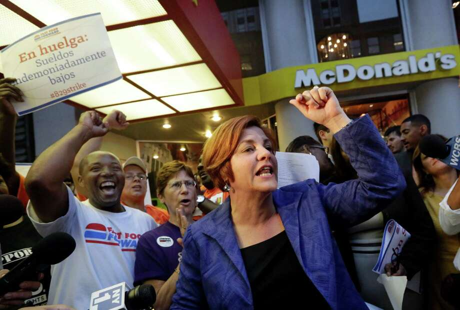 New York City Council Speaker and mayoral candidate Christine Quinn speaks at a fast food workers' protest outside a McDonald's restaurant on New York's Fifth Avenue, Thursday. Organizers say thousands of fast-food workers are set to stage walkouts in dozens of cities around the country Thursday, part of a push to get chains such as McDonald's, Taco Bell and Wendy's to pay workers higher wages. (AP Photo/Richard Drew) Photo: Associated Press