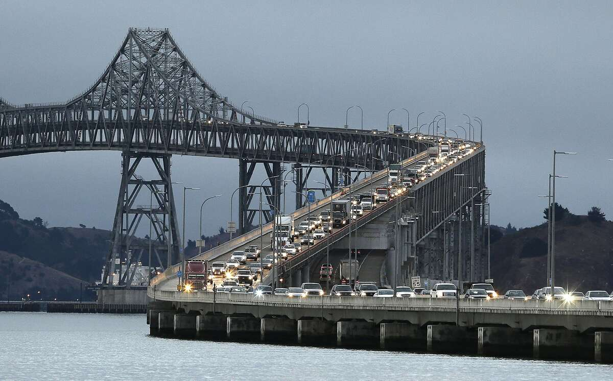 Traffic slows in the morning commute over the Richmond-San Rafael Bridge during the shutdown of the San Francisco-Oakland Bay Bridge Thursday, Aug. 29, 2013, in San Rafael, Calif. Commuters faced their first morning on Thursday without the bridge, but there weren't major traffic snarls as day broke across the Bay Area. Alternate bridges to get into San Francisco were more crowded around 6:30 a.m., and Bay Area Rapid Transit trains appeared to be carrying a heavier load than usual. But commuters were managing to get around. (AP Photo/Eric Risberg)