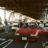 In this photo taken Oct. 17, 1989, motorists turn their cars around and wait to drive back to San Francisco after the upper deck of the Bay Bridge collapsed onto the lower deck in the Loma Prieta earthquake in San Francisco.  It will be nearly 24 years since the 6.9-magnitude Loma Prieta earthquake permanently damaged the existing eastern span, setting off a public works project marked by numerous delays, political fights over its design and complex engineering hurdles. But the newly built east span will open to traffic by Tuesday, Sept. 3, 2013.