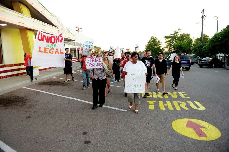 Protesters asking for better wages for fast food workers march outside a McDonald's in Northglenn, Colo. on Thursday. They are asking for $15 an hour for workers in this nationally organized event. Photo: RJ Sangosti, Getty / Copyright - 2013 The Denver Post, MediaNews Group.