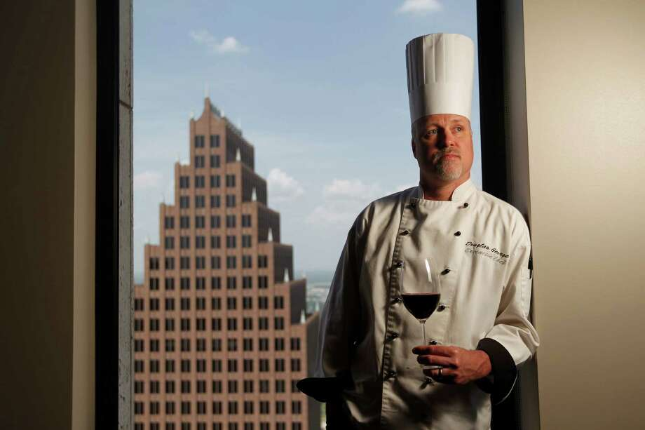 Chef Doug George presides over Allen's Landing restaurant at the new Houston Club on the 49th floor of One Shell Place in downtown. Photo: Johnny Hanson, Staff / © 2013  Houston Chronicle