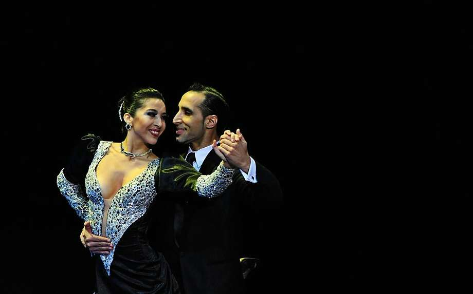 Keep smiling. Maybe they won't notice we forgot the rose:Argentina's Ariel Leguizamon and   Yesica Esquivel dance during the Tango World Championship in Buenos Aires. Photo: Daniel Garcia, AFP/Getty Images