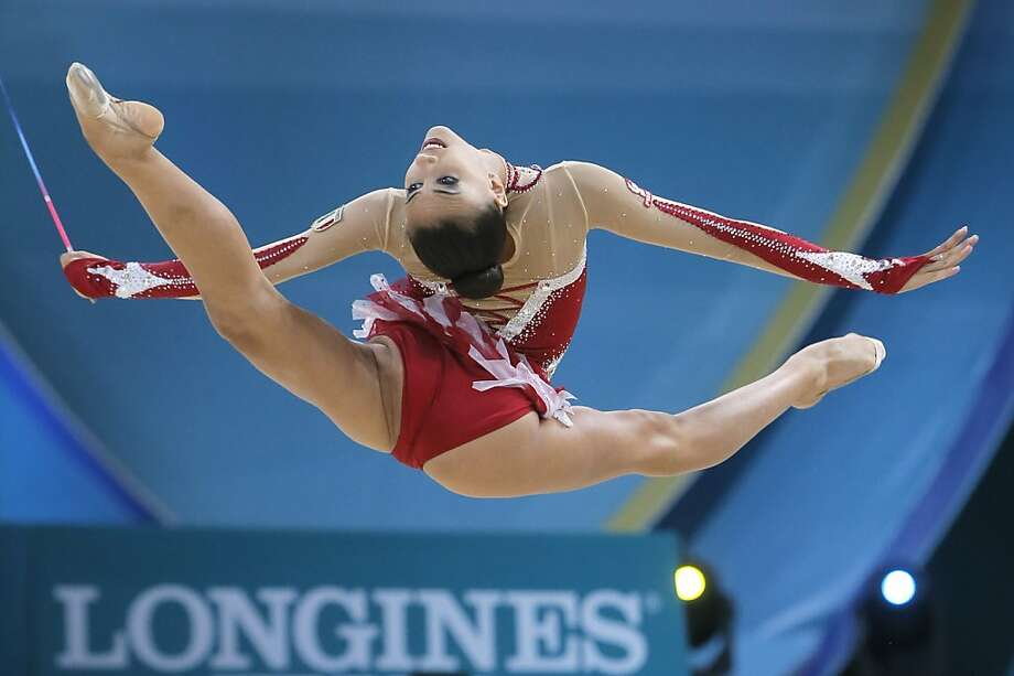 Allesia Russo of Italy performs with a ribbon during the 32nd rhythmic gymnastics world championships in Kiev, Ukraine, Thursday, Aug. 29, 2013. (AP Photo/Efrem Lukatsky) Photo: Efrem Lukatsky, Associated Press