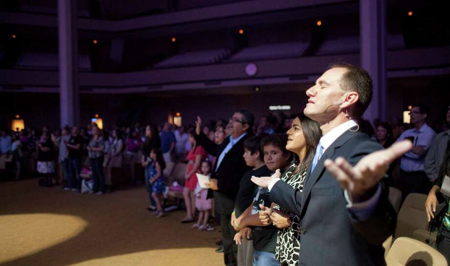 It's not unusual for Second Baptist Church's Spanish-language minister Alfonso Gilbert to hold services using Scripture in Spanish, English, Greek and Hebrew. Photo: Nick De La Torre, Staff / © 2013 Houston Chronicle