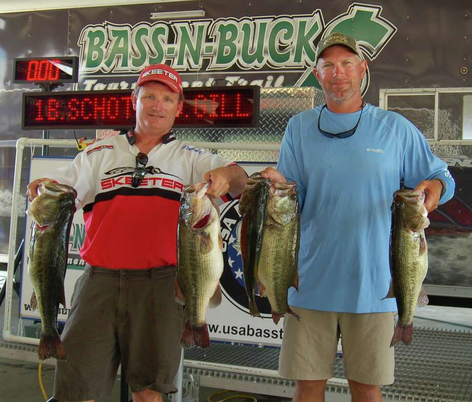 Brian Schott and Scott Gill with some of their 50 pound winning total. Photo by Patty Lenderman