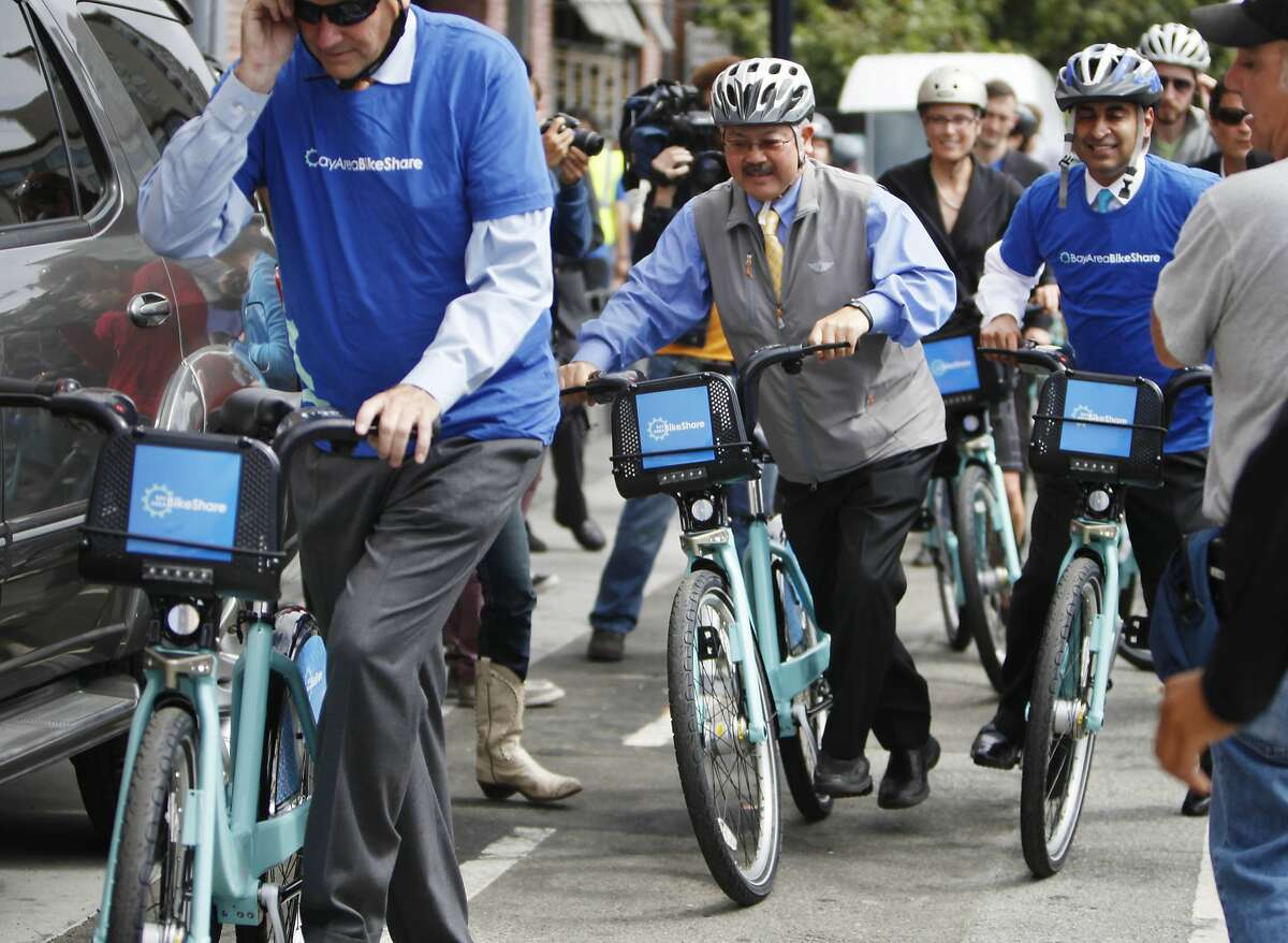 Mayor Ed Lee (second from left) leaves a Bay Area Bike Share station on Townsend at 4th Street to ride to City Hall on a Bay Area Bike Share bicycle on Thursday, August 29, 2013 in San Francisco, Calif.