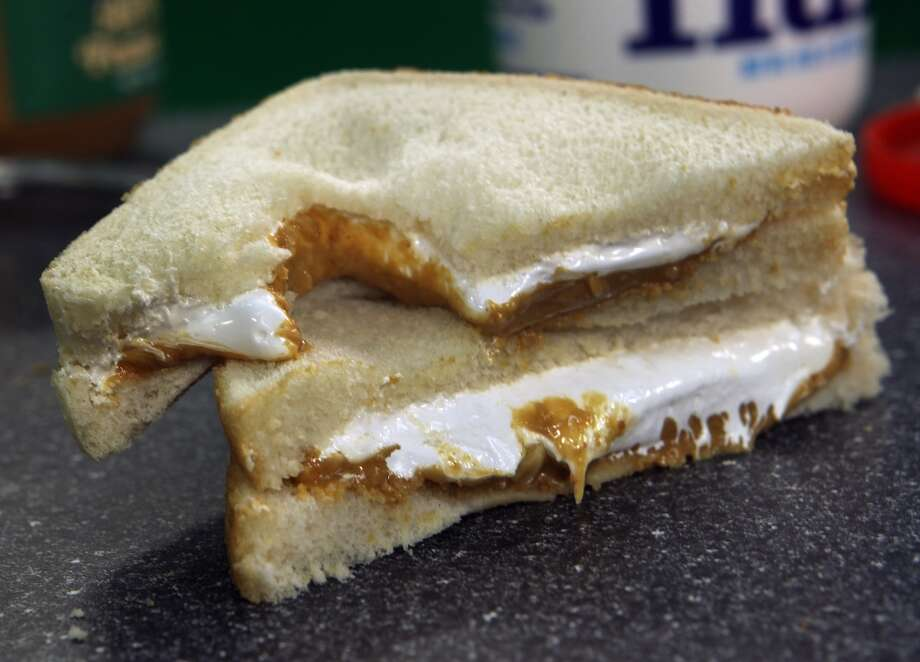 Massachusetts:The Fluffernutter, a delicacy of white bread, peanut butter and marshmallow fluff that gets spongey in your mouth. Purists say it must be made on Wonder Bread. Photo: Boston Globe, Boston Globe Via Getty Images