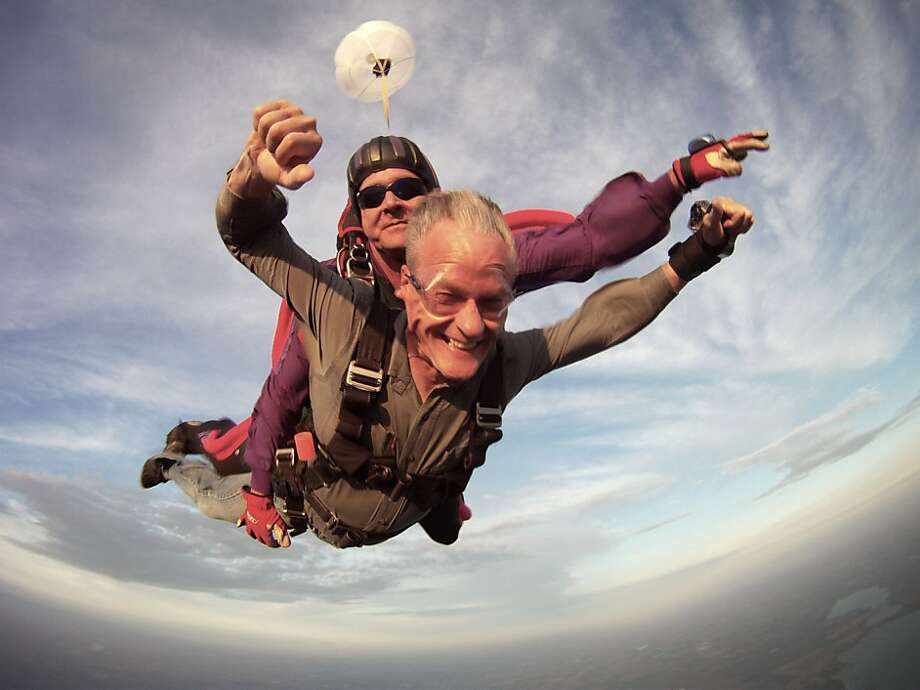 Plunge-worthy: South Dakota Gov. Dennis Daugaard and tandem skydive instructor Dan Spisak 