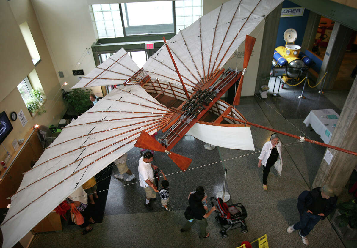 A half scale model of Gustave Whitehead's Airplane #21, which the Bridgeport Herald reported flew at Tunxis Hill in Fairfield on August 14, 1901, two years before the Wright brothers famous Kitty Hawk flight, hangs in the lobby of the Discovery Museum in Fairfield on Sunday, August 14, 2011. The Bridgeport: First in Flight exhibit at the museum celebrates the 110th anniversary of Whitehead's flight, Igor Sikorsky, and the frisbee, which originated as a pie plate at the Frisbee Baking Company on Kossuth Street in Bridgeport.