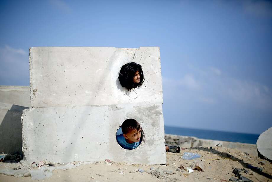 Holes in the wall gang:Palestinian kids play on the beach near the Shati refugee camp in   Gaza City. Photo: Mohammed Abed, AFP/Getty Images