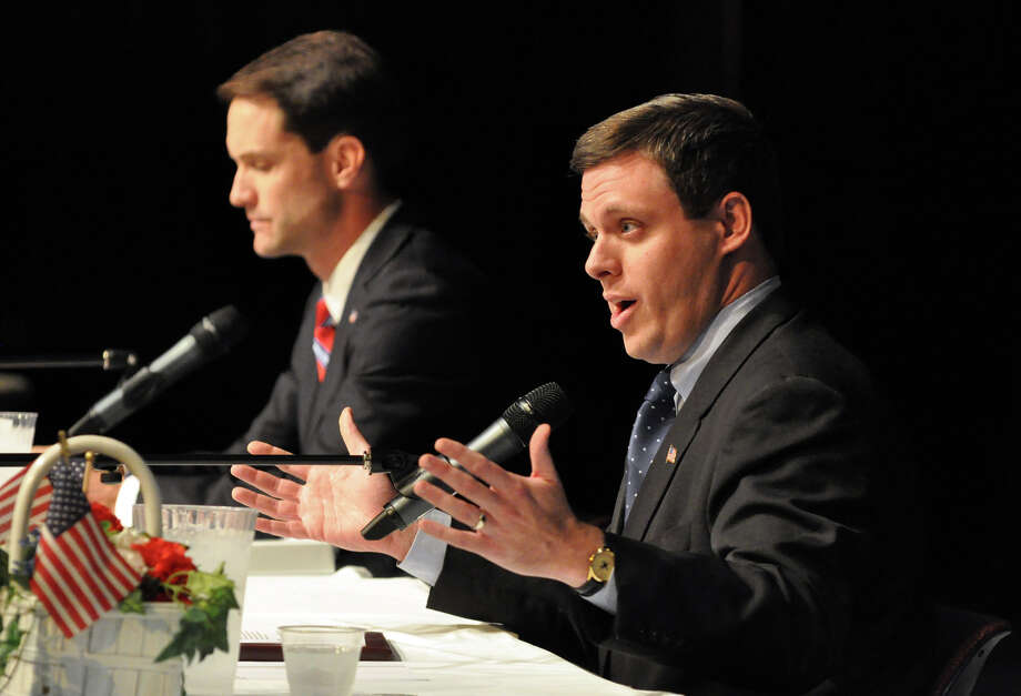 Republican Congressional candidate Dan Debicella, right, answers a question as his opponent Congressman Jim Himes looks on during the 4th Congressional District Candidates' Debate sponsored by the League of Women Voters at Wilton High School on Sunday, Oct. 24, 2010. Photo: Amy Mortensen, File Photo / Connecticut Post Freelance