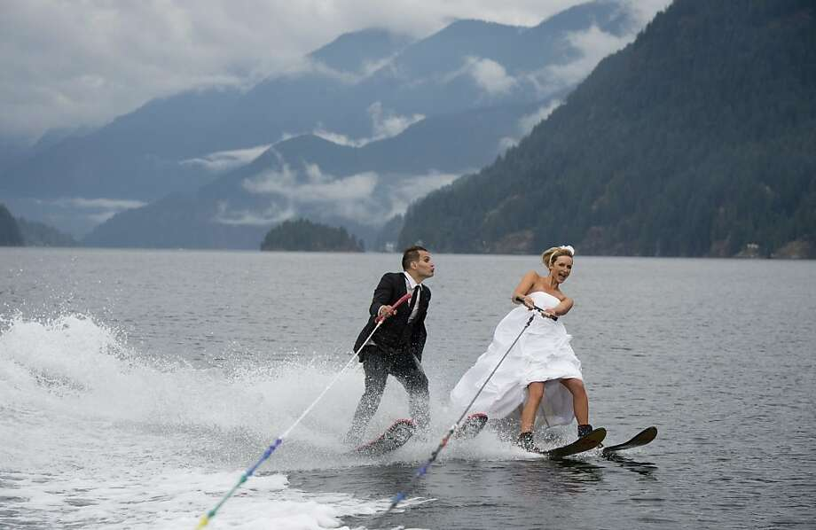 Their marriage is already on the ropes:Newlyweds Cam Auge and Caylee Wasilenko ski Bedwell Bay in North Vancouver, B.C., after exchanging vows on the dock at the Vancouver Waterski Club. Photo: Jonathan Hayward, Associated Press