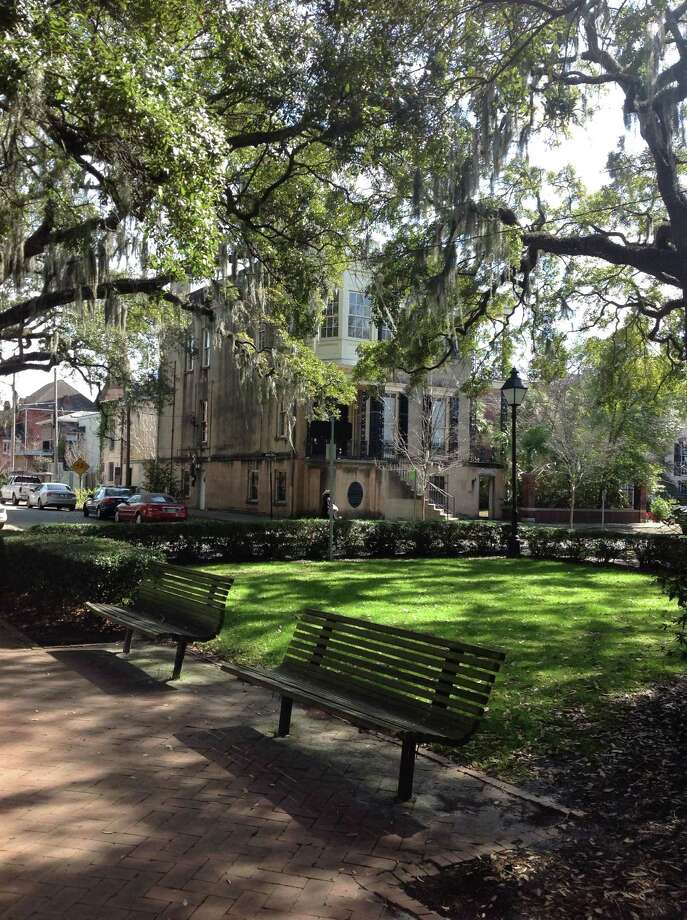 One of numerous historic homes in downtown Savannah. In front are several of the iconic Southern live oak trees that are seen everywhere in Savannah.  (Elizabeth Floyd Mair)