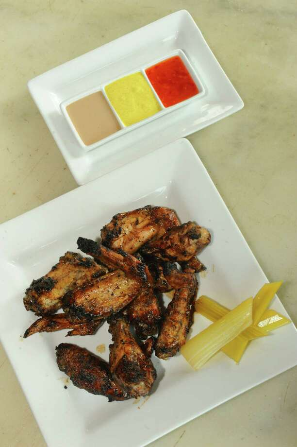 DownTown City Tavern. 21 Elm St., Glens Falls.Tandoori roasted chicken wings with pickled celery and dipping sauce at DownTown City Tavern on Thursday Aug. 22, 2013 in Glens Falls, N.Y. (Michael P. Farrell/Times Union) Photo: Michael P. Farrell / 00023600A