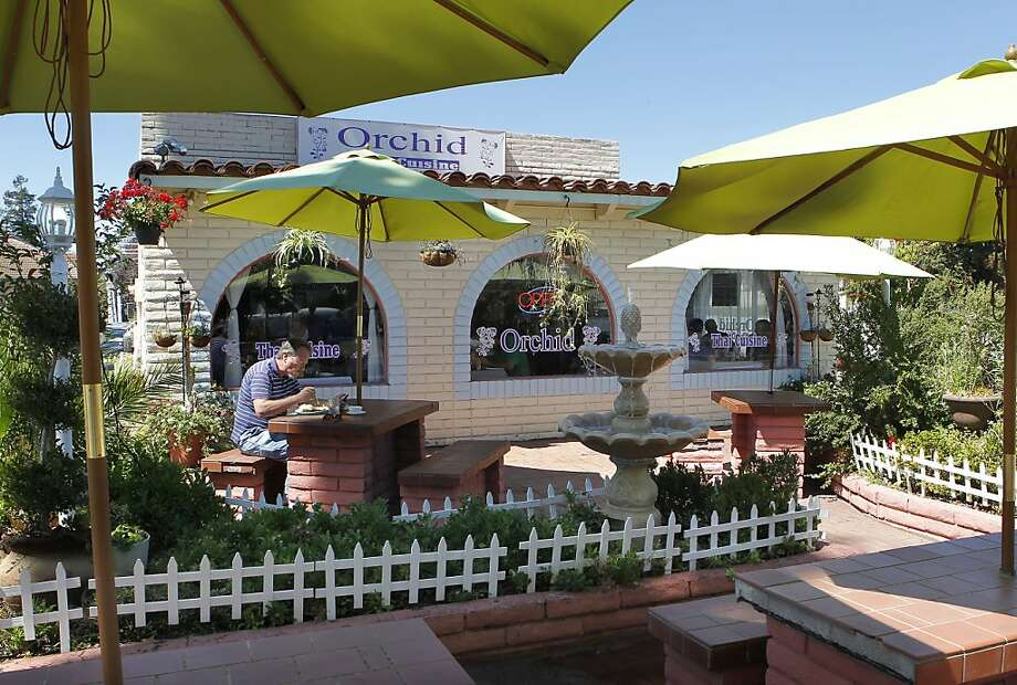 The patio area of the Orchid Thai Cuisine restaurant in Milpitas. Owner Varunga Suriyachaiporn loved the Taco Bell setting. Photo: Michael Macor, San Francisco Chronicle