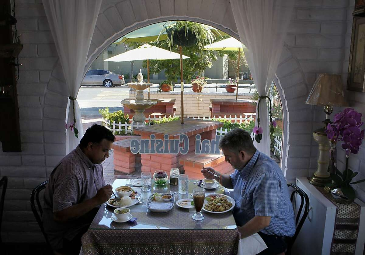 Roshan Perera, (left) and Jay Sams stop for lunch at the Orchid Thai Cuisine restaurant in Milpitas, Calif. on Thursday August 29, 2013. The many ways business owners have transformed the iconic Taco Bell restaurant buildings throughout the Bay Area.