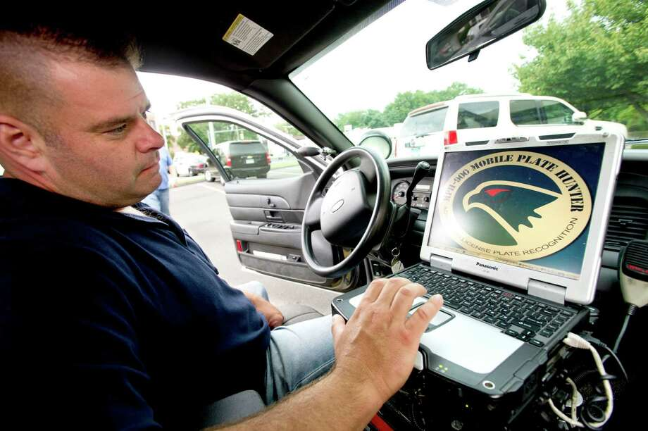 Sgt. Kevin Fitzgibbons opens the software that works with the license plate cameras mounted to the trunk of his Stamford Police car at police headquarters on Thursday, August 29, 2013. Photo: Lindsay Perry / Stamford Advocate