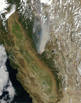 The Rim Fire, an lengthy wildfire in California's Sierra Nevada and along the edge of Yosemite National Park, began on Aug. 17. By Aug. 23, a day after this picture was taken, the fire had already consumed more than 100,000 acres. (NASA)