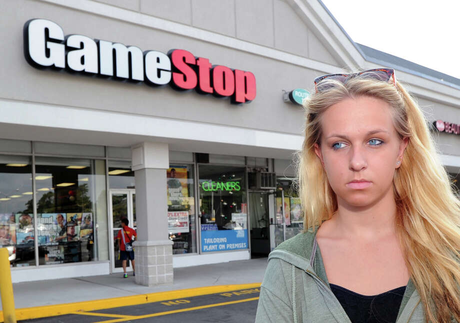"Beata Palosz, 18, of Greenwich, in front of the Game Stop store in Port Chester, N.Y., Thursday, August 29, 2013. The video gaming retailer was a favorite of Beata's brother, Bartlomiej ""Bart"" Palosz, 15, who according to police, committed suicide Tuesday night at his family's home in Byram. Photo: Bob Luckey / Greenwich Time"