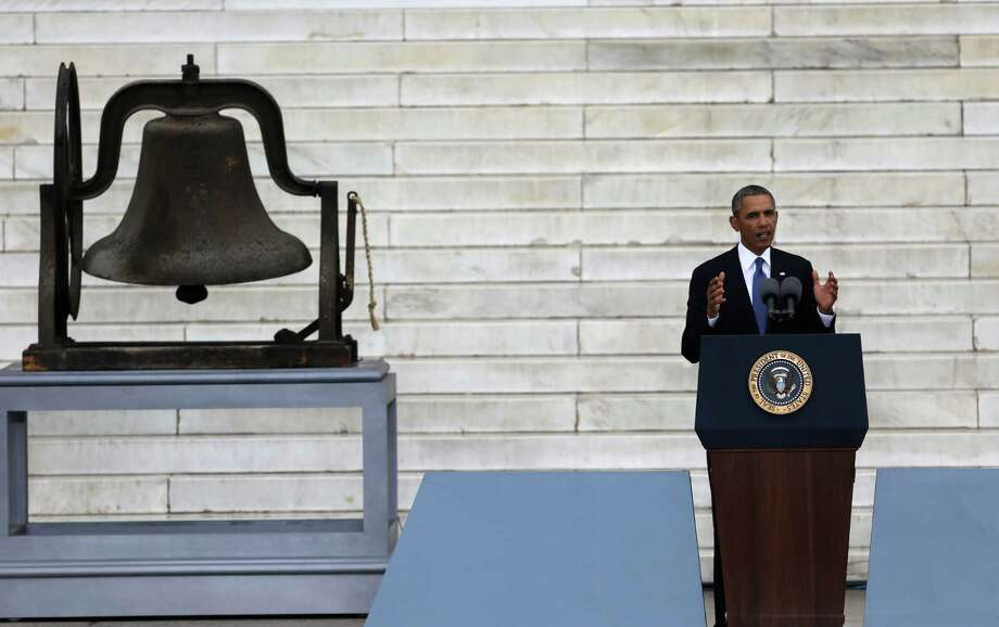 President Barack Obama speaks at the Let Freedom Ring ceremony at the Lincoln Memorial Wednesday, Aug. 28, 2013, in Washington, to commemorate the 50th anniversary of the 1963 March on Washington for Jobs and Freedom. Photo: Carolyn Kaster, Associated Press / AP