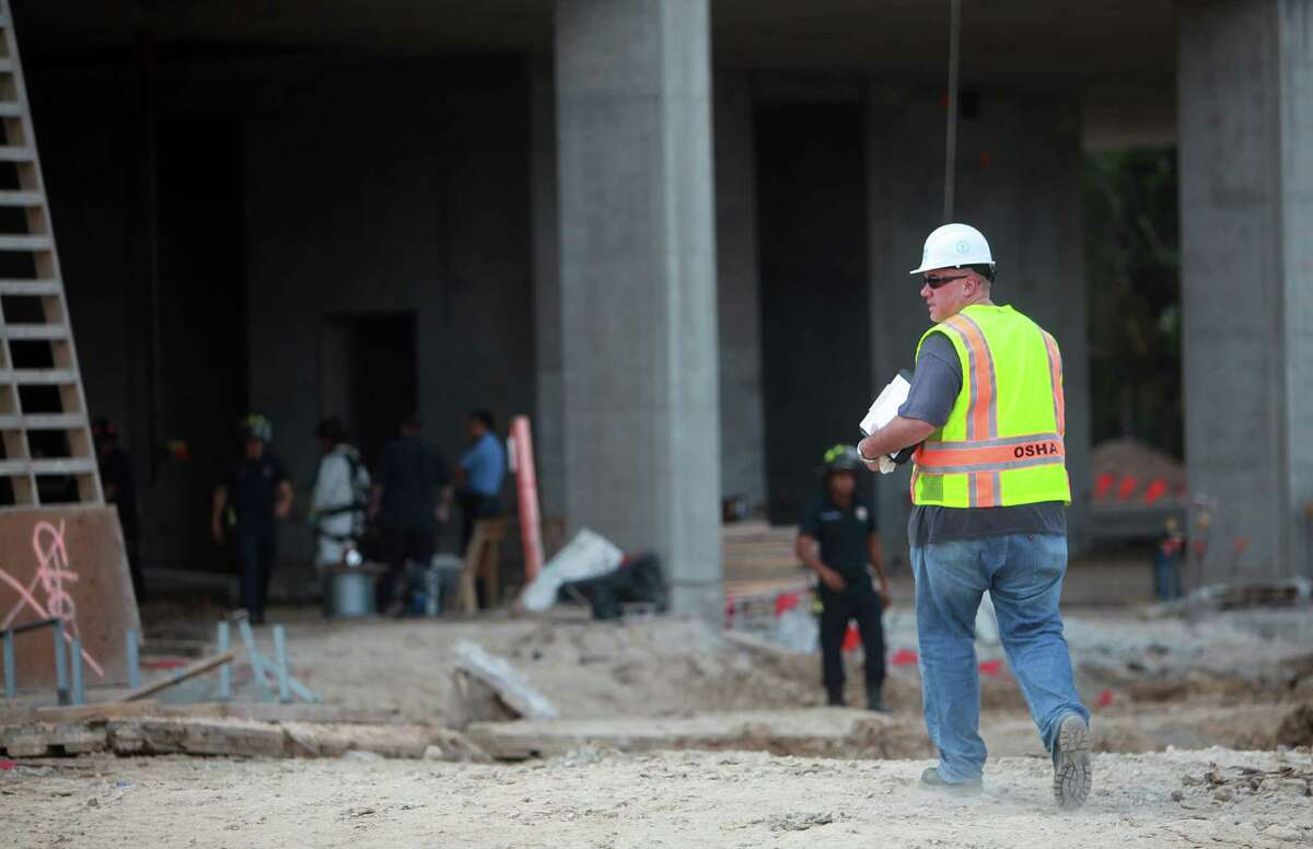 OSHA is on the scene to investigate an industrial accident where a construction worker plunges to his death through an elevator shaft at 2929 Weslayan on Thursday, Aug. 29, 2013, in Houston. All workers were sent home with no other injuries.