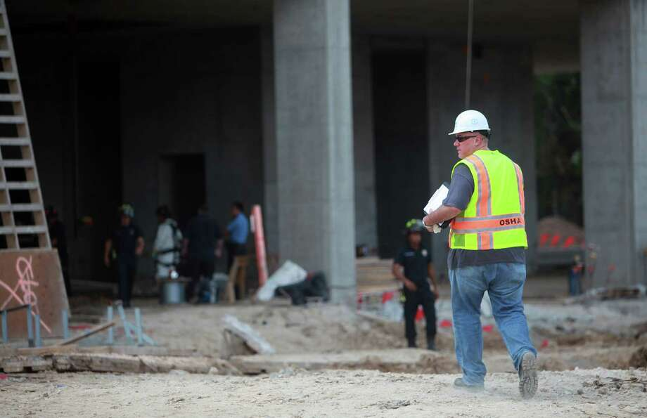 WORK SAFETY: Federal occupational safety and health inspectors have stopped workplace inspections except in cases of imminent danger. Photo: Mayra Beltran, Houston Chronicle / © 2013 Houston Chronicle